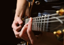 Guitarist-Hands-Playing-Guitar-48210287
